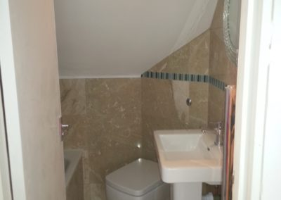 New ensuite bathroom in loft space - shower bath, basin & toilet