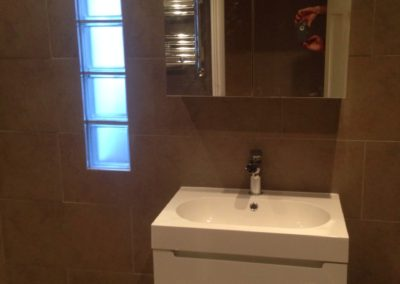 Bathroom makeover with marble tiles, glass bricks, new fittings